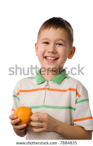 The smiling boy with an orange on a white background - stock photo