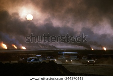The smoke from oil well fires forces Kuwait drivers to use their headlights during daylight. Retreating Iraqi troops set fire to Kuwait's oil fields. April 22 1991. - stock photo