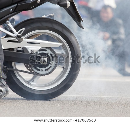 the smoke of motorcycle wheels - stock photo