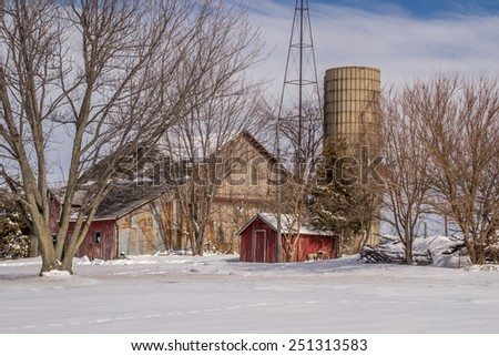 The snow covered rural farm scene in Northern Illinois.  - stock photo