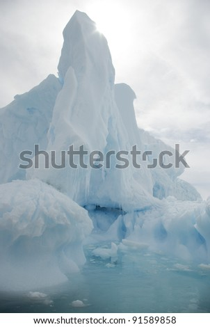 The snow-white iceberg in the Antarctic summer sun background - stock photo