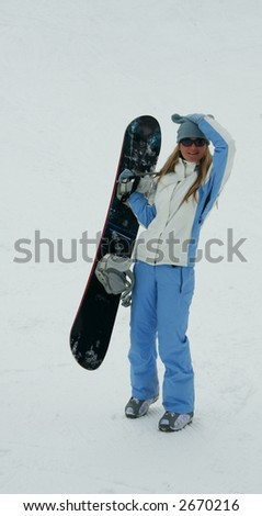 The snowboarder on snow background - stock photo