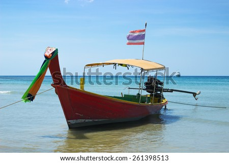 The so-called long-tailed Thai boat near the shore - stock photo