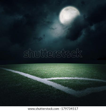 the soccer field at the moon light - stock photo