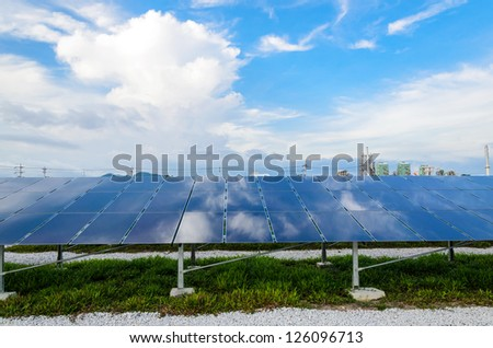 The solar cells with the blue sky background - stock photo