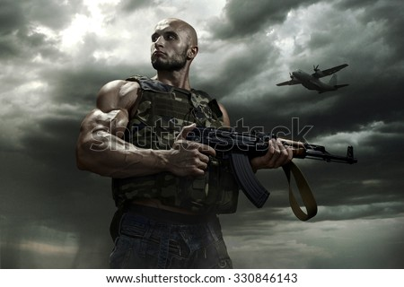 the soldier on a background of storm dramatic clouds. With some color corrections - stock photo