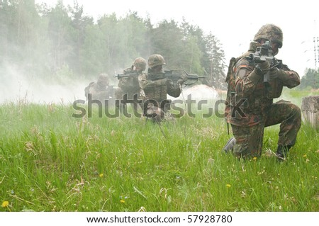 The soldiers of the Bundeswehr in the zone of military operations. In the smoke. - stock photo