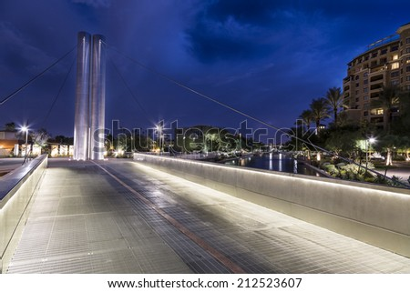 The Soleri Bridge over the Salt River Project Arizona Canal in the  Waterfront District of downtown Scottsdale Arizona photographed at  night. - stock photo