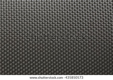 the solid background of a gray carbon fiber - stock photo