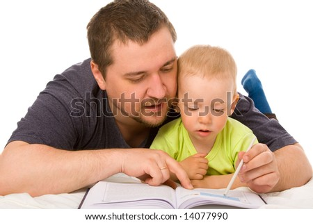 The son with father reads the book on a white background - stock photo