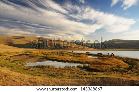 The Song Kol Lake, Kyrgyzstan mountains - stock photo
