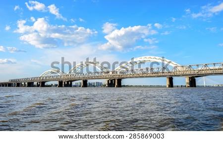 The Songhua River and Binzhou Railway Bridge, located in Harbin City, Heilongjiang Province, China. - stock photo