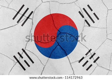 The South Korea flag painted on a cracked desert ground surface - stock photo