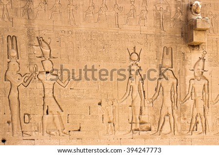 The south wall of the temple of Hathor at Dendera with lion-headed waterspouts. Cleopatra and her son Caesarian (on the left side) - stock photo