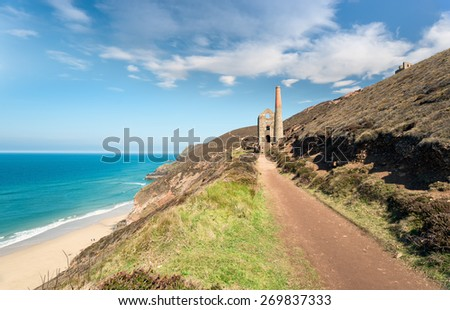 The South West Coast Path as it passes St Agnes on the north coast of Cornwall - stock photo