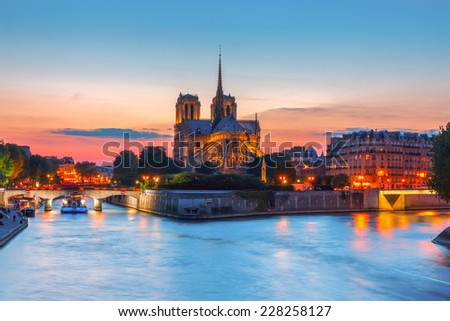 The southern facade of Cathedral of Notre Dame de Paris at sunset - stock photo