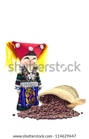 the souvenir dolls in hill tribe clothes and sack with red beans, azuki bean spilling out over on white background - stock photo