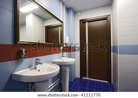 The spacious modern bathroom which has been laid out by a tile - stock photo
