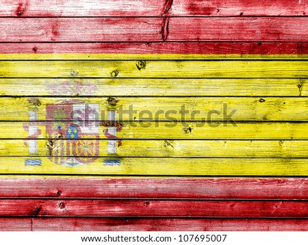 The Spanish flag painted on wooden fence - stock photo