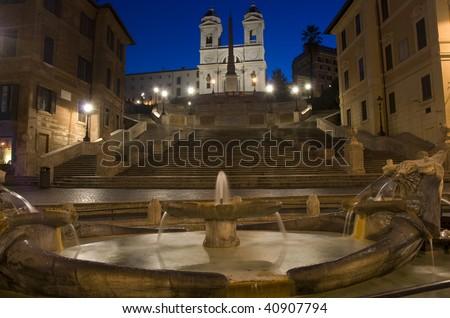 """The Spanish Steps in Rome. """"Barcaccia"""" fountain in foreground and """"Trinità dei Monti"""" church in background - stock photo"""