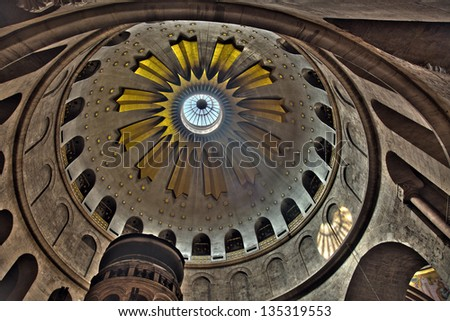 The spectacular Dome of the Rotunda just above the Edicule at the Church of the Holy Sepulchre in the old city of Jerusalem, Israel. - stock photo