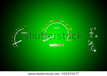 The speedometer of a car on a green color background. - stock photo
