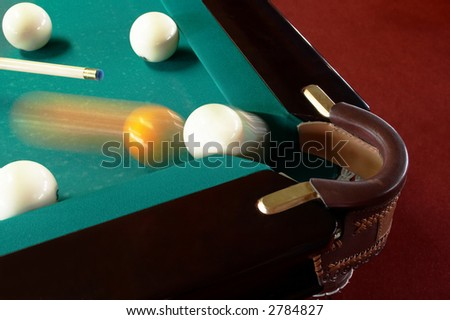 The sphere which slides in a billiard pocket - stock photo
