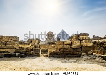 The Sphinx and the pyramid of Cheops in Giza in the background of a Sun Cairo Giza - stock photo