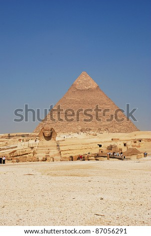 the sphinx and the  pyramid of giza - stock photo