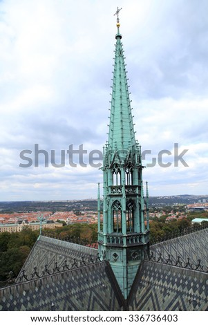The spire of the tower of medieval Cathedral of St. Vitus, Prague, Czech Republic - stock photo