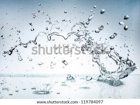 The splash splashing in the white background - stock photo