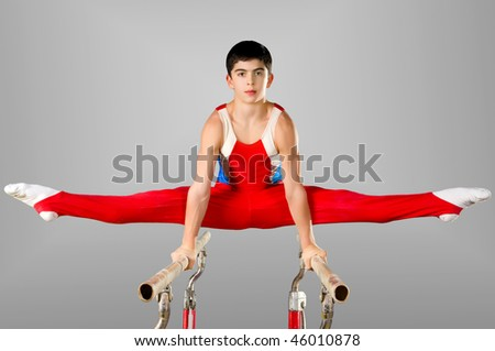 The sportsman the guy, carries out difficult exercise, sports gymnastics - stock photo