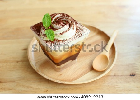 The square cup of banoffee pie from the top view with selective focus on the banoffee - stock photo