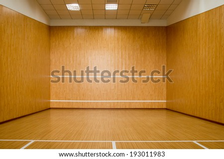 The squash court, pure wood floor - stock photo
