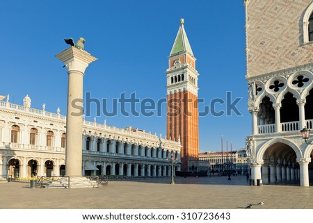 The St. Mark's Square (Piazza San Marco) with Campanile and Doge's Palace, early in the morning. Venice, Italy - stock photo