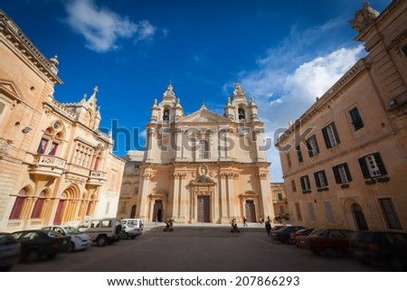 The St. Paul's Cathedral in Malta's old capital Mdina in late afternoon against a deep blue sky. - stock photo