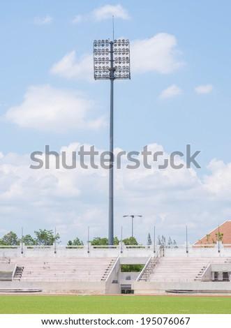 The Stadium Spot-light tower over Blue Sky - stock photo