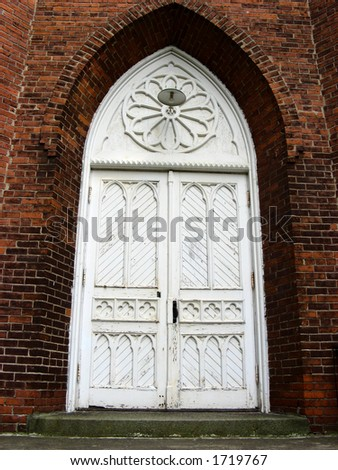 The Stained Church Door - stock photo