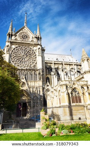 The stained glass window in the form of rose on the southern facade of the Cathedral of Notre Dame de Paris in France. - stock photo