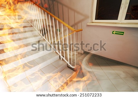 The staircase burns in the building  - stock photo