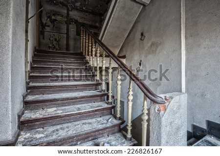 The staircase was destroyed and abandoned building - stock photo