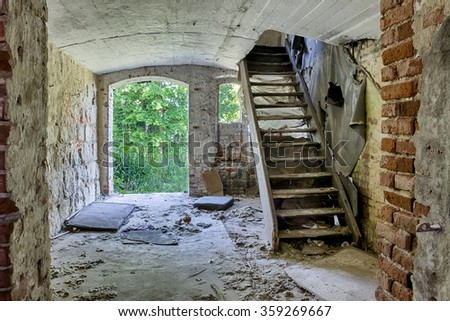 The staircase was destroyed and abandoned old building - stock photo