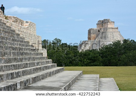 The stairs of  Governor's Palace at the Pyramid of the Magician in the background.