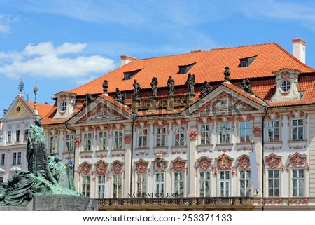 The statue of Jan Hus, one of the most important personalities in Czech history, and the Golz-Kinsky Palace - the National Gallery in Old Town Square in Praque, Czech Republic. - stock photo