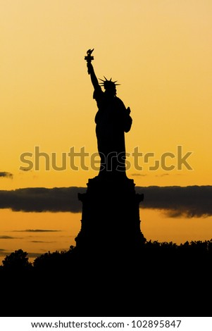 The Statue of Liberty at sunset in New York city. - stock photo