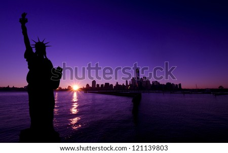 The Statue of Liberty at sunset in New York city, USA - stock photo