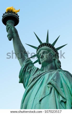 The Statue of liberty Manhattan, New York, USA. Half body view isolated on blue sky background. - stock photo
