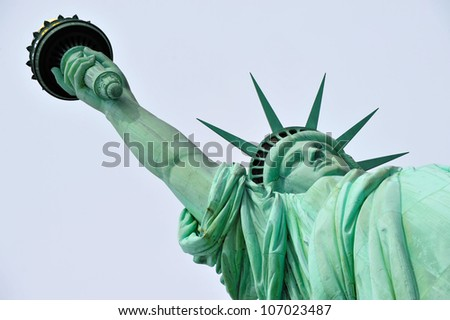 The Statue of liberty Manhattan, New York, USA.low angle isolated on blue sky background. - stock photo