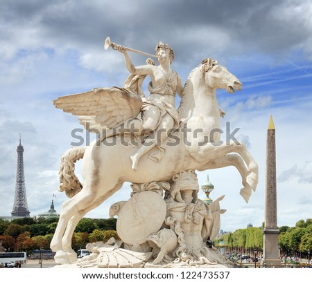 The statue of Renommee, or the fame of the king, riding the horse Pegasus (by Antoine Coysevox) at the west entrance of the Tuileries Garden in Paris, France. - stock photo
