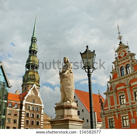 The statue of Roland and House of Blackheads and Church of St. Peter in the center of Riga. - stock photo